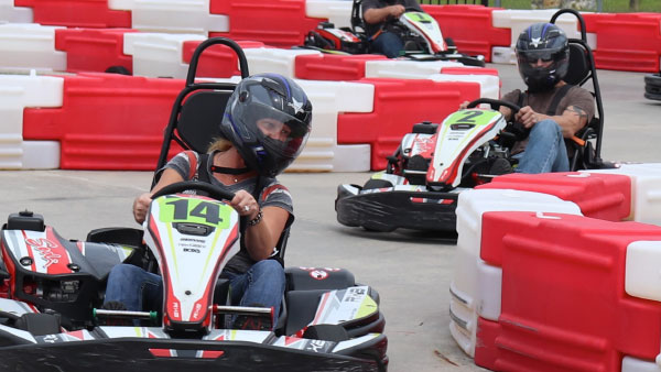 Riders taking S curses at max speed in Go-Kart