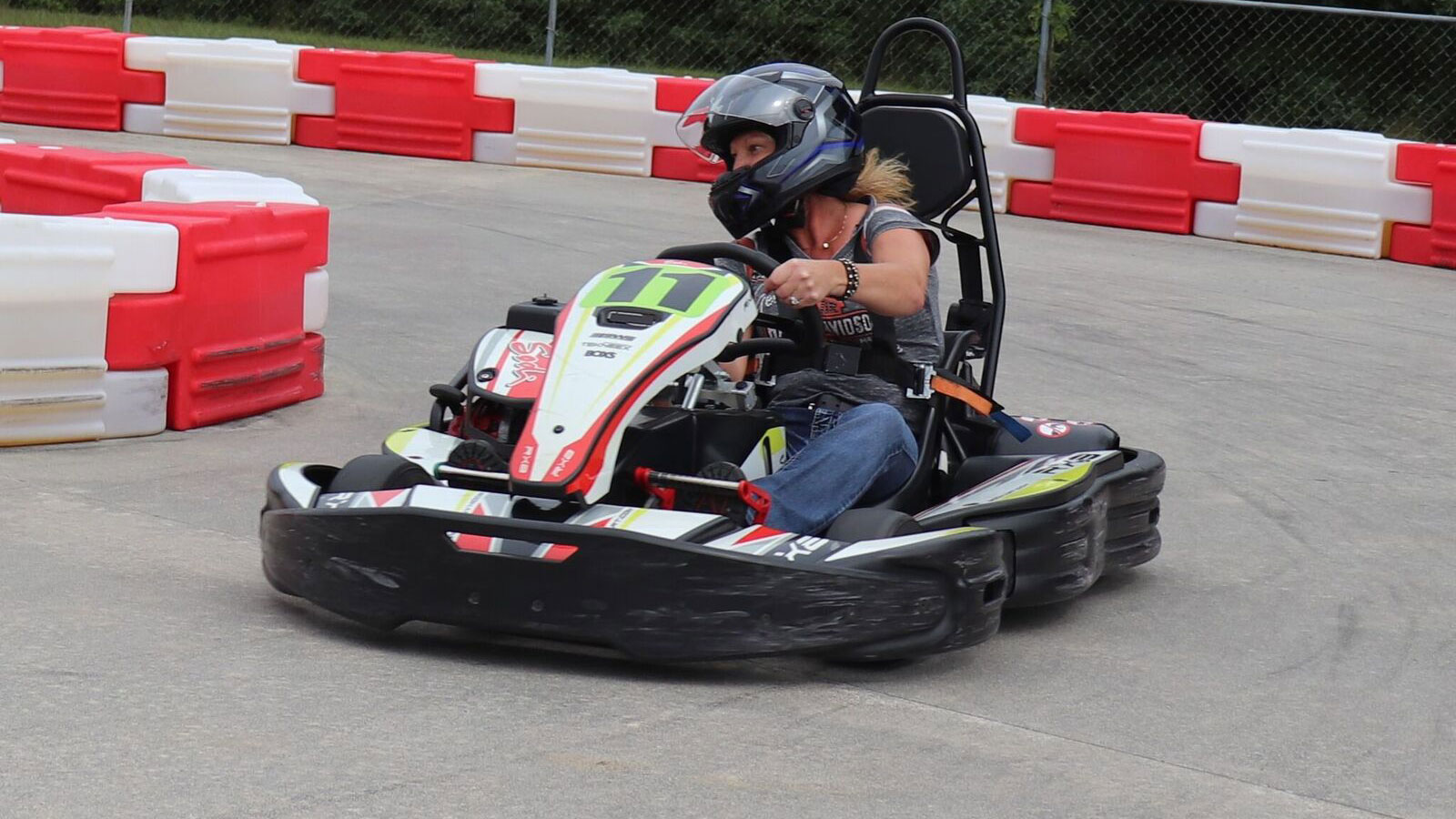 Woman speeding through a corner on ProTrack Go-Kart